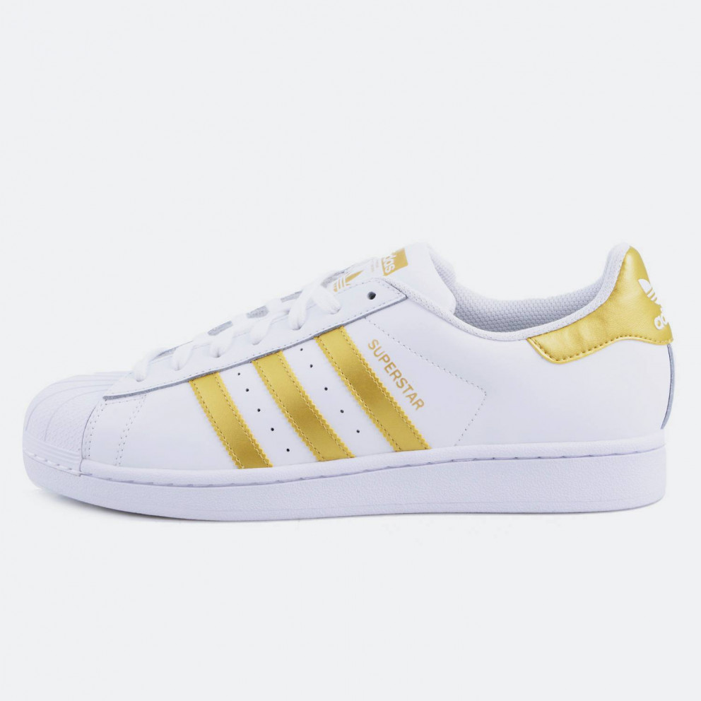 adidas shoes with peach stripes black background